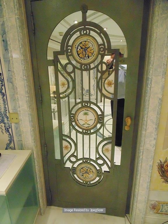 Lot 1251 - Iron door 750mm x 1950mm x 45mm with a central mirror panel and bespoke cast window grill design