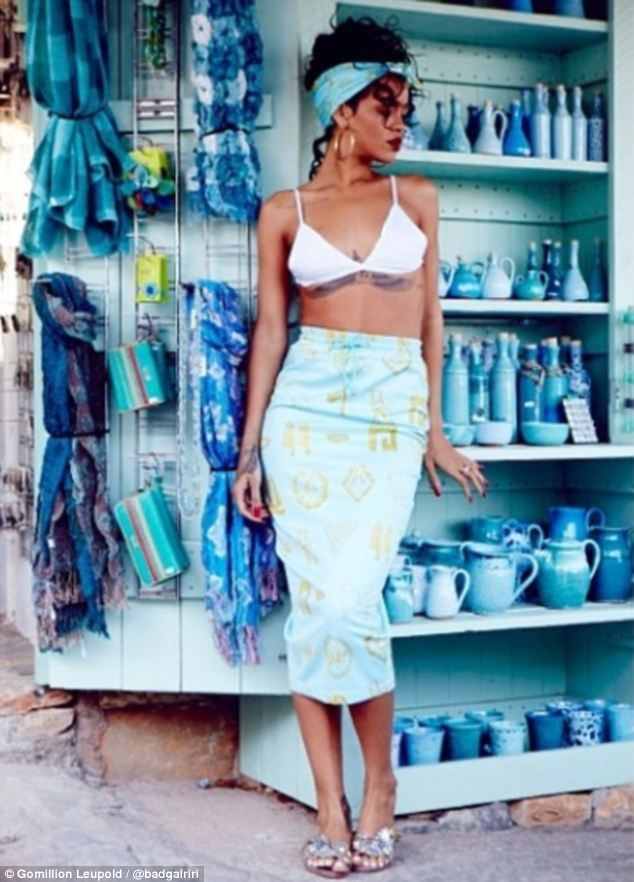 Grecian goddess: The megastar queen singer Rihanna models a colourful gold and turqouise patterned skirt