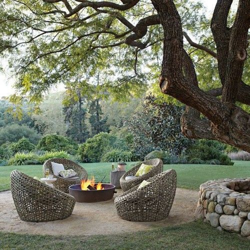 my kind of backyard, love the shade of that tree, the stone border, the chairs and the fire pit!!!!