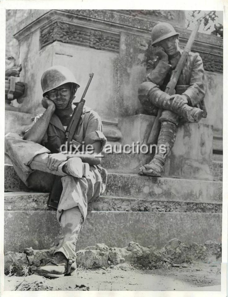 1943- Sergeant Norwood Dorman stops to rest at the memorial to the Italian soldier of World War I in Brolo, Sicily.