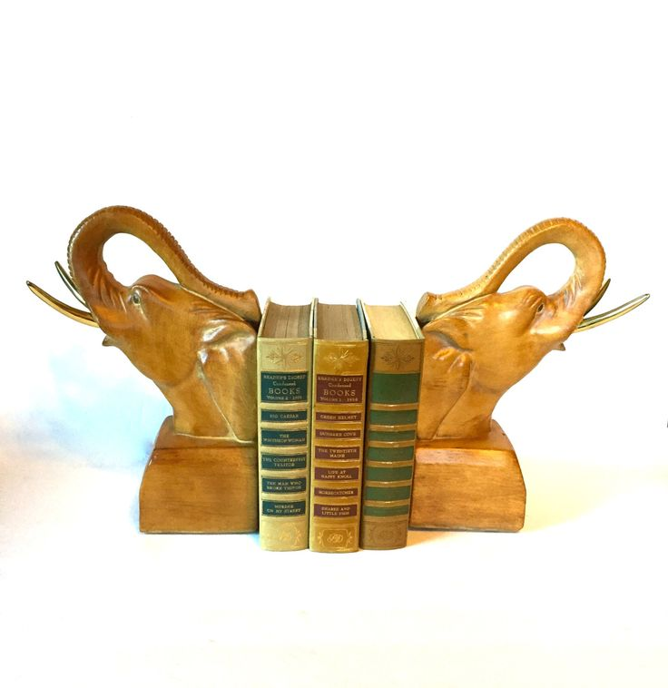 Vintage Pair of Elephant Bookends, Brass Tusks, Repos LA, California by 33rdStreetRevisited on Etsy https://www.etsy.com/listing/258316285/vintage-pair-of-elephant-bookends-brass