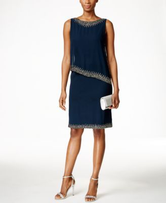 J Kara Beaded Capelet Dress $169.99 J Kara's sheath dress boasts another layer of sophistication thanks to an asymmetrical overlay and beautiful beaded details.