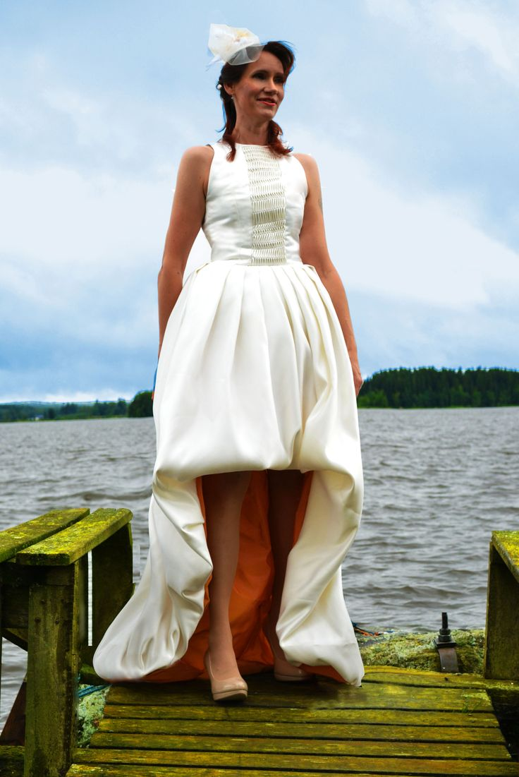 Simple white wedding dress with an orange lining-twist. Shorter on the front, Interesting texture element on the top part of the dress