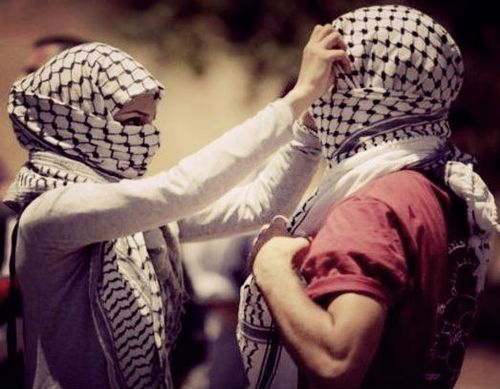 A young Muslim married couple, proudly going to a protest for Palestine together
