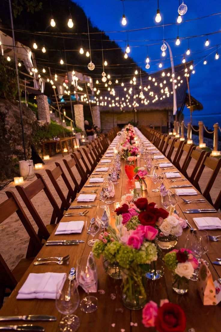 Love the matching wood chairs with the natural wood table, accented with rustic lighting above.
