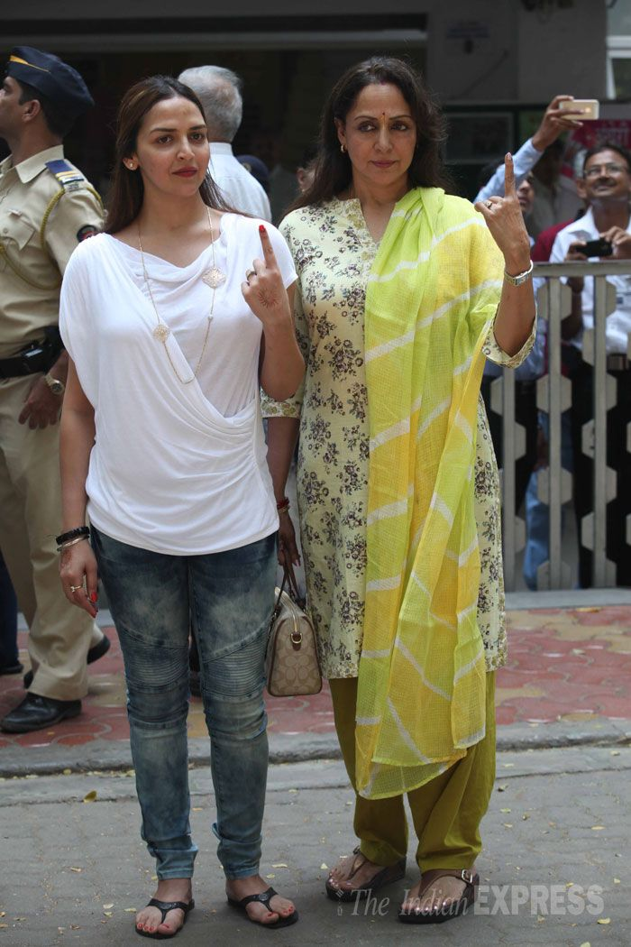 Hema Malini seen outside a polling booth with her elder daughter Esha Deol during the Maharashtra assembly polls 2014.