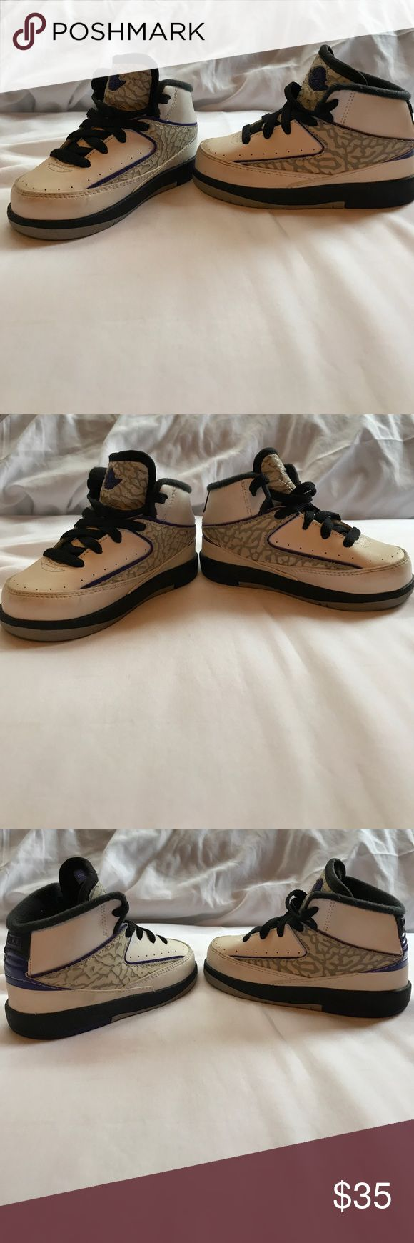 Nike Air Jordan Retro 2 Grape Concord Style:	Nike Air Jordan Retro 2 Grape Concord Size:	6C Children  Original Box:	 Not Available These shoes have only been worn a handful of times. Shows some signs of wear great pre owned condition. Air Jordan Shoes Sneakers