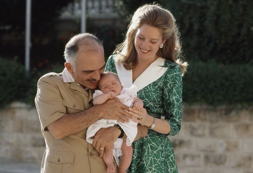 420010.  King Hussein, Jordan's leader since 1952, and his wife, Queen Noor, the former Lisa Halaby of Washington, D.C., pose with their daughter, Princess Iman.