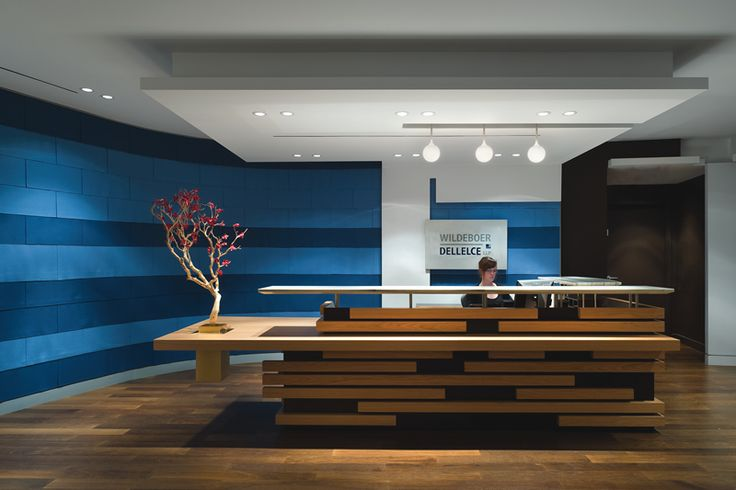 Blue stripped walls, wood floor, great drop and recested lighting- not to even speak about the very cool reception desk.