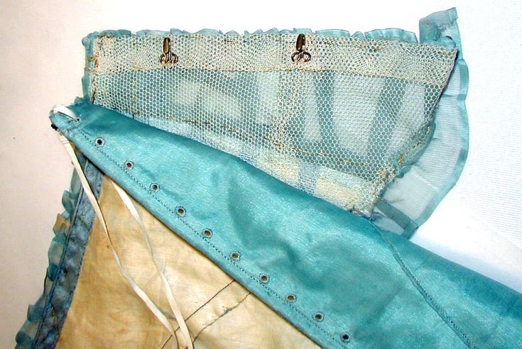 Ca.1860 teal evening body with net bertha, via Martha McCain article. Either Met Museum or Museum of the City of New York, not clearly ID'd.