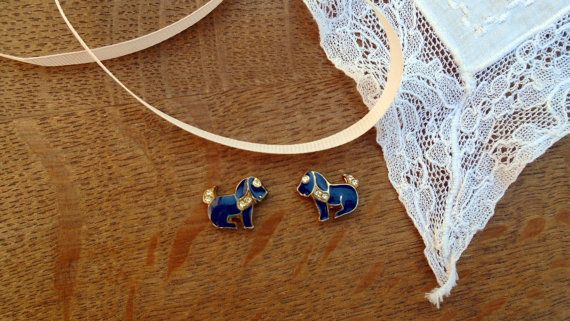 These small vintage dogs are made from blue and gold enamel with small diamante detailing. These were previously earrings however the rods were