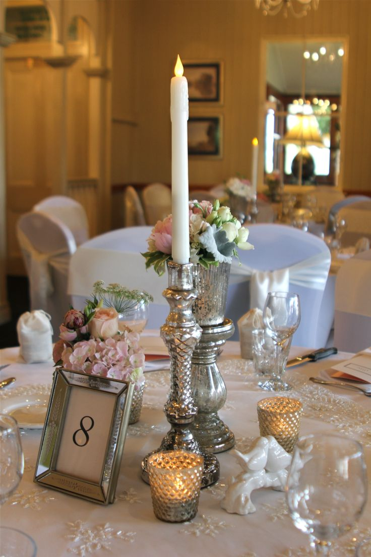 Pretty silver and champagne mercury glass centrepiece by Adorn Event Hire (flowers by Kate Dawes) Venue: Topiaries, Samford QLD