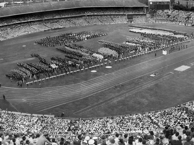 Crowds watch the opening ceremony. Picture: Herald Sun Image Library