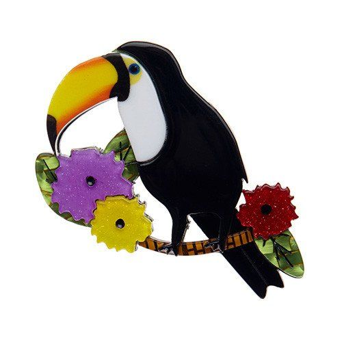 From Erstwilder's newest Tiki collection, a brooch showing a toucan perching on a green branch complete with exotic flowers. Height 6 cm, width 5 cm. Laser cut resin, hand assembled and hand painted, presented in a branded box as shown, with a cute teapot tag.