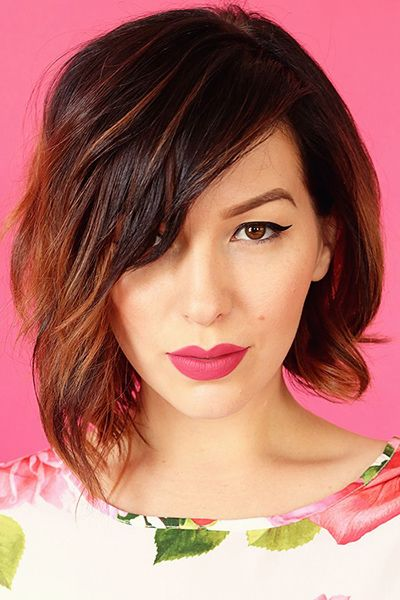 asymmetrical bob haircut - Long, sideswept bangs perfectly complement a slightly asymmetrical bob. Read more: http://www.dailymakeover.com/trends/hair/fall-haircuts-2014/#ixzz3E0iCOTfa: