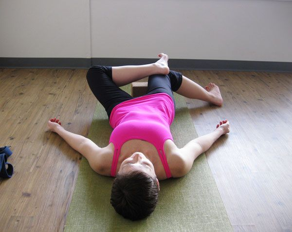 If you have tight IT (illotial bands) or you hips experience a popping sensation, then perform this hip stretch which lengthens the outer the hip by internally rotating the hip. Push down on the leg with the opposite foot for a more intense stretch.