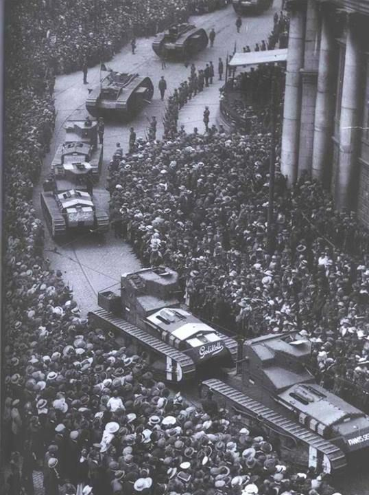 British Tanks roll through Dublin during the Irish Civil War. Most likely taken at College Green with the Bank of Ireland building on the right.