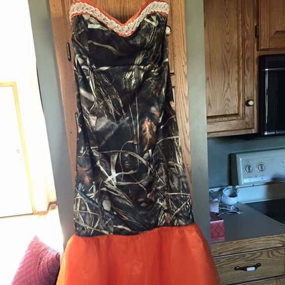 Camouflage Prom Dress It was custom made! And it is super gorgeous, just want someone to love it as much as I did for prom! It is a mermaid style, and can fit anywhere from a size 10-14 because of the corset back! It is Realtree Max 4 camo! Dresses Prom