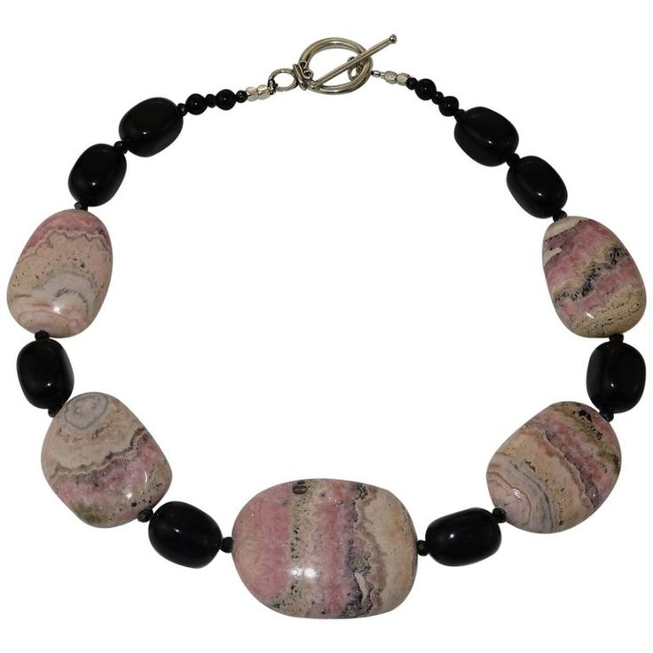 Argentine Rhodochrosite and Black Onyx Necklace with Sterling Silver Clasp | From a unique collection of vintage beaded necklaces at https://www.1stdibs.com/jewelry/necklaces/beaded-necklaces/