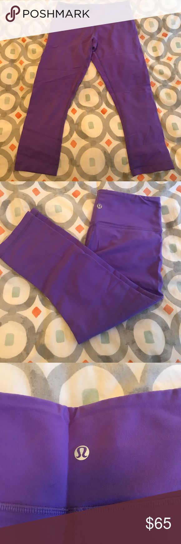 Purple Lululemon yoga/running crop legging! Purple Lululemon yoga/running crop legging! Just like these one but different color— https://shop.lululemon.com/p/women-crops/Wunder-Under-Crop-III-Full-On-Luon/_/prod240008?color=0001 lululemon athletica Pants Leggings