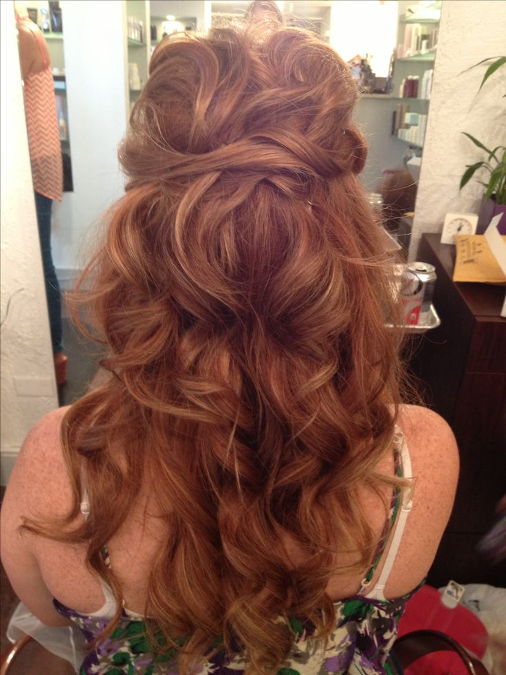 Half up half down bridal hair...perfect for pinning a veil in! Maybe not as curly?