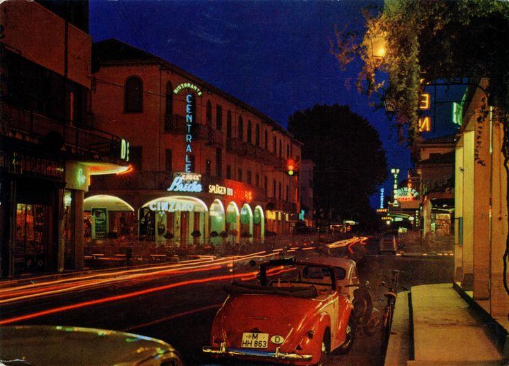"""Italy - Lido di Jesolo - 1976 - front   Night on Earth #15 Sreamin' the Light #28  1976 postcard of Italy / Italia, Lido di Jesolo, featuring FIAT 600 + 500 C """"Topolino Giardiniera Legno"""", VESPA 1500, a bike and a wonderful German convertible from Munich"""