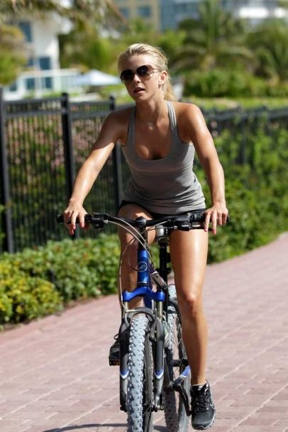 Julianne Hough goes for a bike ride in the morning with her personal trainer and her sister Sharee in Miami