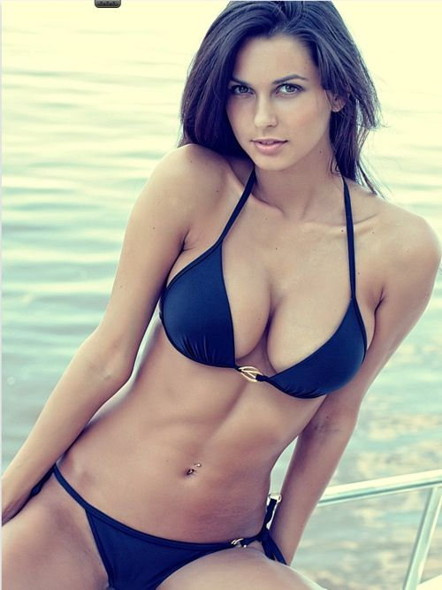Brunette on the water.  Sure, the air brushing could be better.