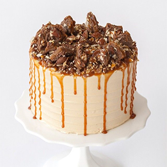 Salted Caramel Toffee Cake | Cake is for those who love decadence but want an alternative to chocolate. It features three layers of classic vanilla cake filled with homemade salted caramel buttercream, toffee pieces and caramel drizzle. The cake is then finished with chunks of our Bobbette & Belle English toffee, more caramel, and just a touch of edible gold leaf!  #bobbetteandbelle