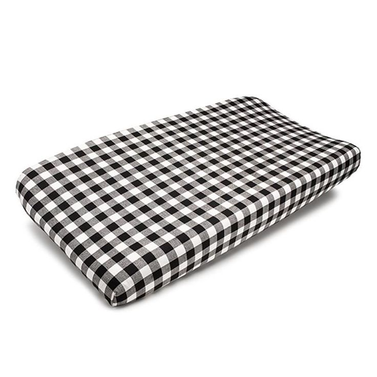 """This black and white plaid pattern looks great as a changing pad cover. The plaid is a 1"""" repeat. Fits all standard changing pad covers. All cotton and made in USA."""