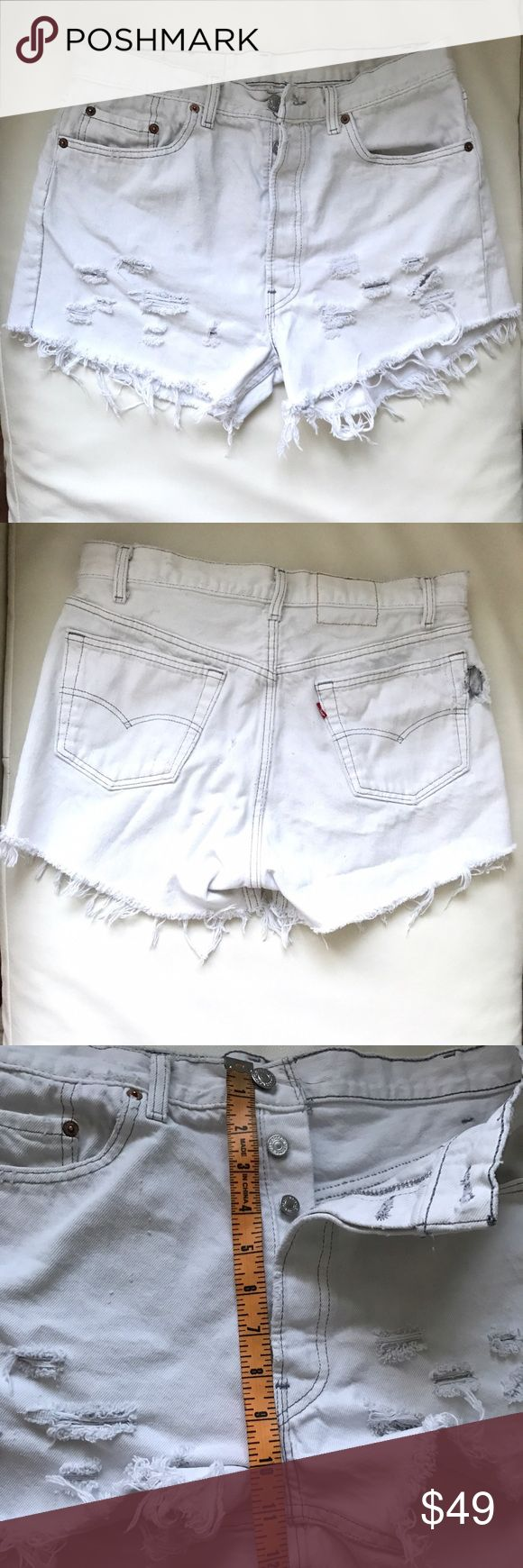 LEVI's vintage white denim cut-off jeans shorts 34 Pre-loved. Soft and wearable. Distressed. Has a small hole on left back pocket and big hole in right back pocket (see pictures). Nothing a budding seamstress can't fix. Levi's Shorts Jean Shorts