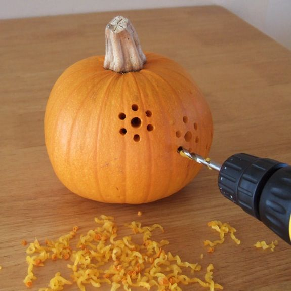 "Pumpkin Carving With A Drill - what a creative Thanksgiving idea for all of our pumpkins! Let the children draw a design or words that have to do with giving thanks, then follow the directions from this site for cutting out the design. I think we'll try two pumpkins and the words ""Happy"" and ""Thanksgiving"" for our table centerpiece..."