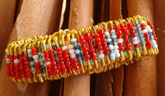 Bracelet made with safety pins dressed with multicolor beads. www.valeart.gr