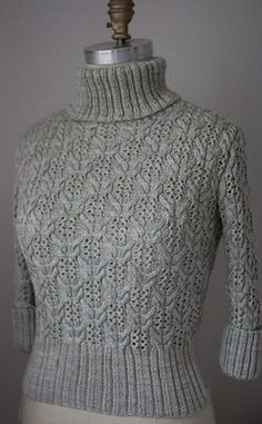 Пуловер с высоким воротником связан спицами. Пуловер связан спицами №3,5 и длиной сорок сантиметров и круговыми спицами №3,25. Кроме того вам понадобится одна дополнительная спица для вязания основного узора. Подробное описание пуловера приведено для трех размеров: для обхвата груди 86,5/99/114,5 сантиметров. Пряжа использовалась смесовая - шерсть плюс шелк. Пуловер с укороченными рукавами три четверти, часть которых связана резинкой 2 на 2. Описание вяззания пуловера вы можете посмотреть…