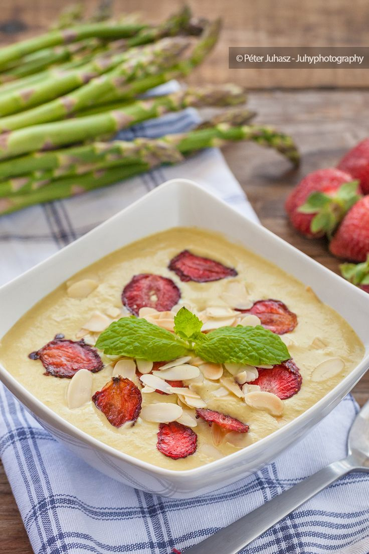 Asparagus cream soup with mint, strawberry chips and roasted almonds