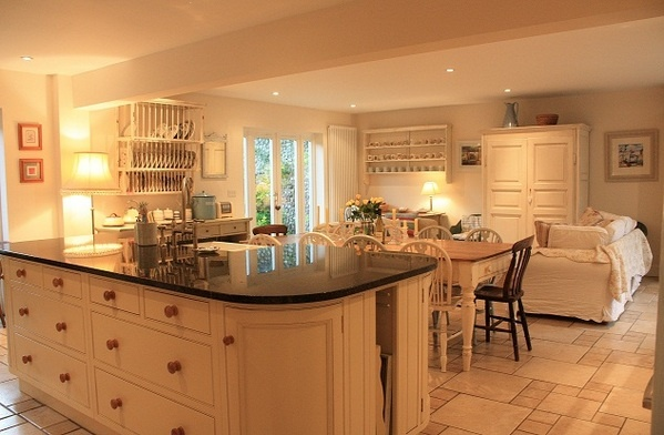 Large cream painted family kitchen with sofas