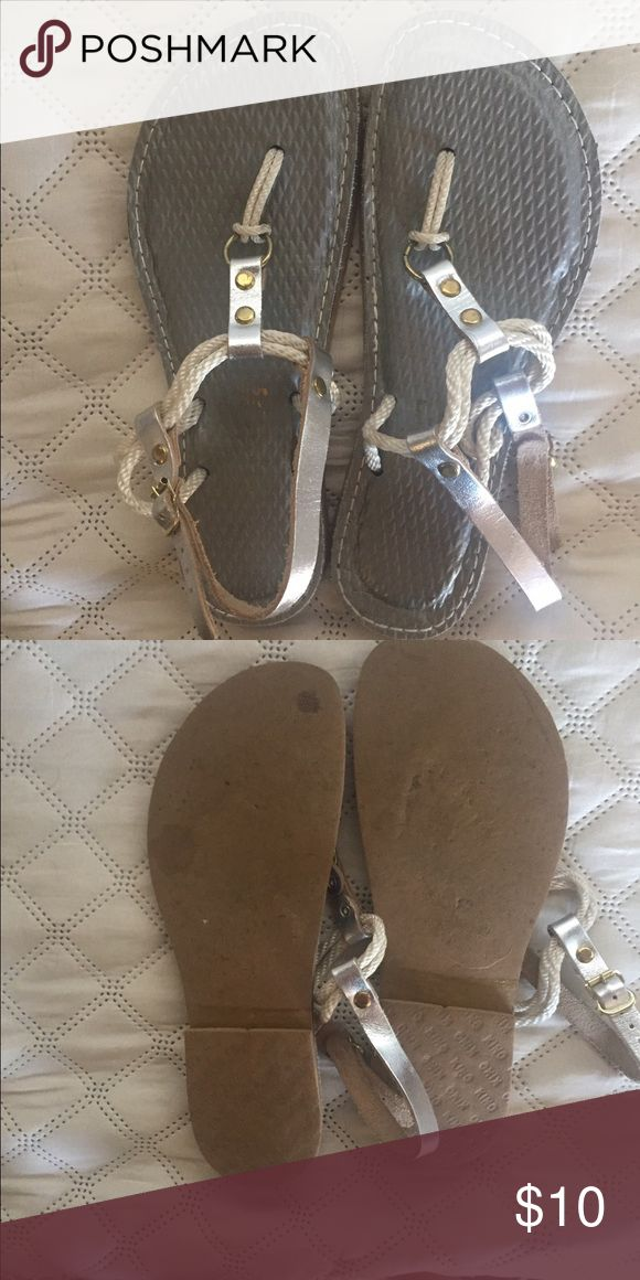 Sandals Cute rope sandals bought in Key West Florida. Hardly worn, I have too many shoes 👠. Silver with cream ropes. Hand made in Key West, FL Key West Shoes Sandals