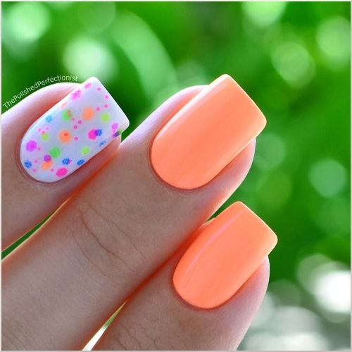 Polished peach nails with a splatter paint accent nail