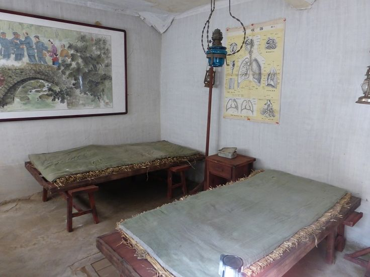 The kind of hospital beds used. Other beds called kangs had a space beneath in order to burn coal for warmth. The guys on these beds would have been cold, given the extreme lack of supplies!