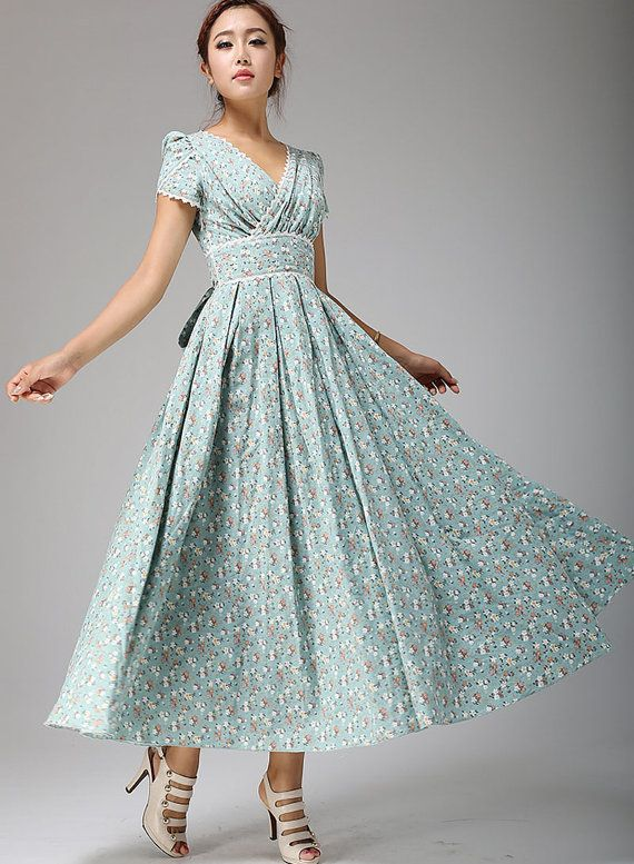 Steal the spotlight at your special occasion with this gorgeous floral maxi linen dress in soft duck egg blue.