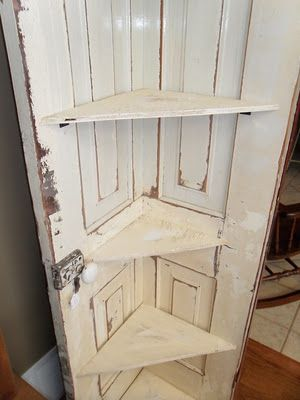 Corner shelf from an old door. Simply cut the door in half and add hinges or nails, and shelves. Be sure to add a low shelf near the floor to help stabilize and prevent tipping.