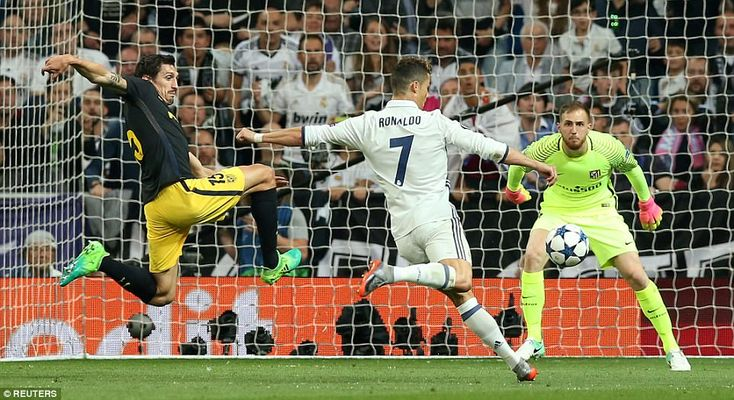 Ronaldo prepares to smash home his second of the night, despite the best efforts of Oblak and Savic to block his volley