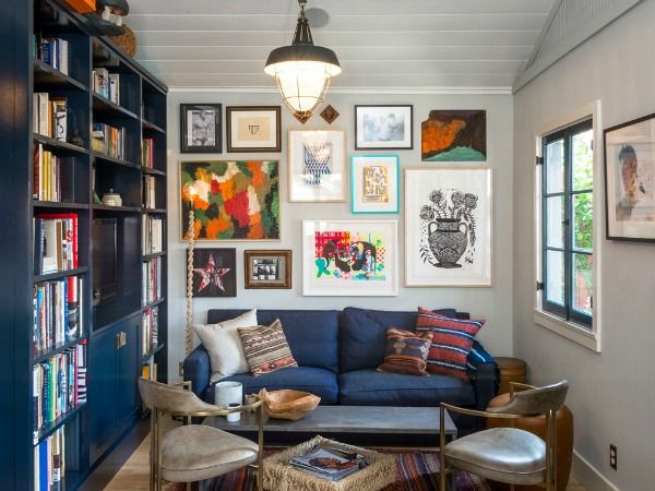 Love these navy blue bookshelves and art gallery wall in a tiny bungalow for sale in Los Feliz | hookedonhouses.net