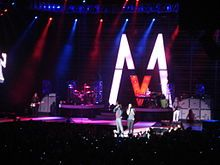 Maroon 5-- is an American pop rock band that originated in Los Angeles, California. It currently consists of lead vocalist Adam Levine, keyboardist and rhythm guitarist Jesse Carmichael, bassist Mickey Madden, lead guitarist James Valentine, drummer Matt Flynn, and keyboardist PJ Morton. Before the current group was established, the original four members, Adam Levine (lead vocals, lead guitar), Jesse Carmichael (rhythm guitar, backing vocals), Mickey Madden (bass guitar) and Ryan Dusick…