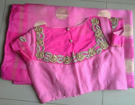 Pink Kota saree with dark pink border paired with back high neck blouse with net and gold silver applique work and pearls buttons.