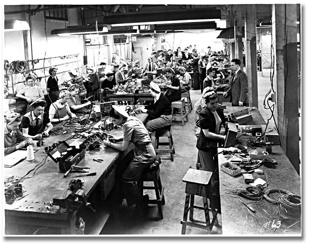 Women soldering and assembling cables for airplanes, Canadian Car and Foundry Co., Brantford, Ontario, 1945.