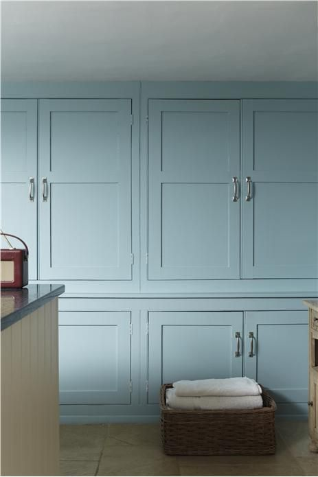An inspirational image from Farrow and Ball - Kitchen with cupboards in Blue Ground nr 210 Estate Eggshell and unit in Wimborne White nr 239 Estate Eggshell.
