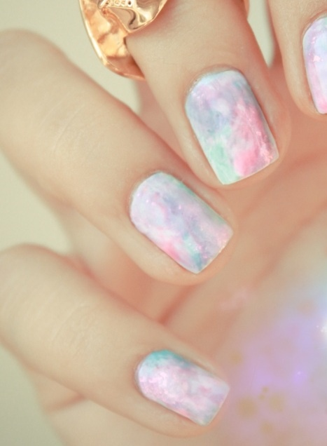 Awesome opal style nails with a hint of rose gold. Colours look amazing with that metal