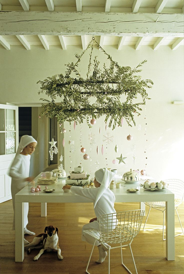 Christmas Tea under an olive branch decorated candelabra. Photo by Frederic Vasseur/The Interior Archive. From www.thehousemag.com.