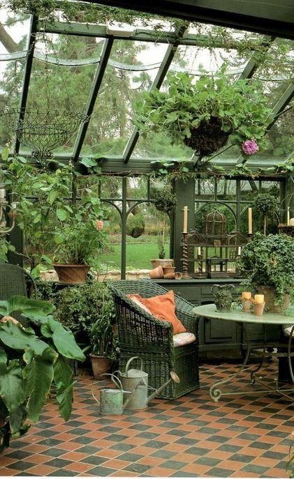 Beautiful Green Iron Sunroom With Patterned Tile Floor And